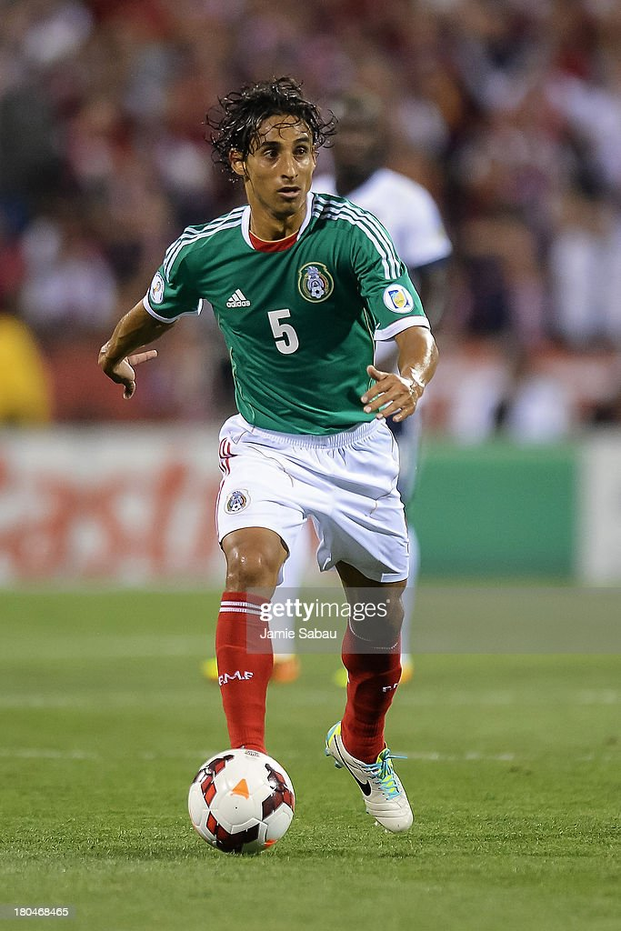 <a gi-track='captionPersonalityLinkClicked' href=/galleries/search?phrase=Fernando+Arce&family=editorial&specificpeople=697001 ng-click='$event.stopPropagation()'>Fernando Arce</a> #5 of the Mexico Men's National Team in action against the United States at Columbus Crew Stadium on September 10, 2013 in Columbus, Ohio.