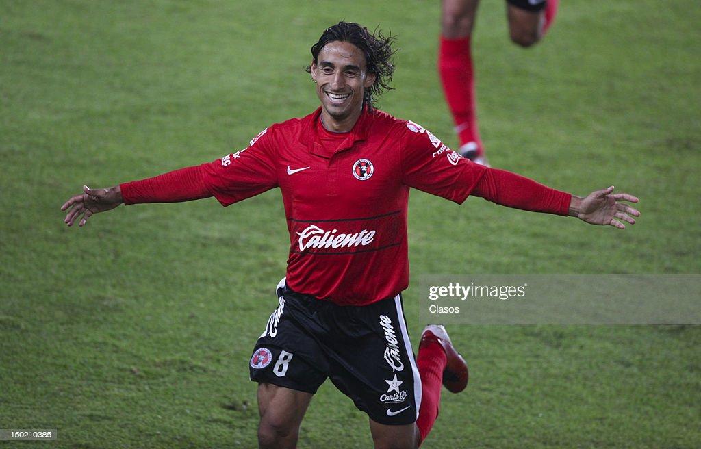 Fernando Arce of Tijuana celebrates a goal during the match of soccer between Pachuca vs Tijuana as part of the Torneo Apertura 2012 at Hidalgo...
