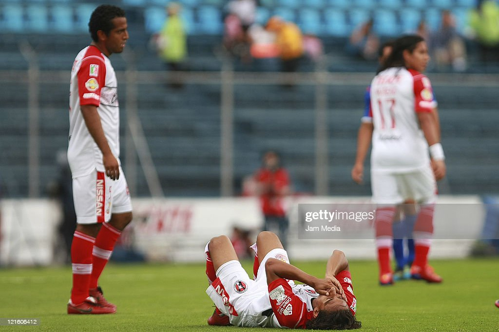 <a gi-track='captionPersonalityLinkClicked' href=/galleries/search?phrase=Fernando+Arce&family=editorial&specificpeople=697001 ng-click='$event.stopPropagation()'>Fernando Arce</a> (C) of Tijuana react during a match between Cruz Azul and Tijuana as part of the Apertura 2011 at Azul Stadium on August 20, 2011 in Mexico City, Mexico.