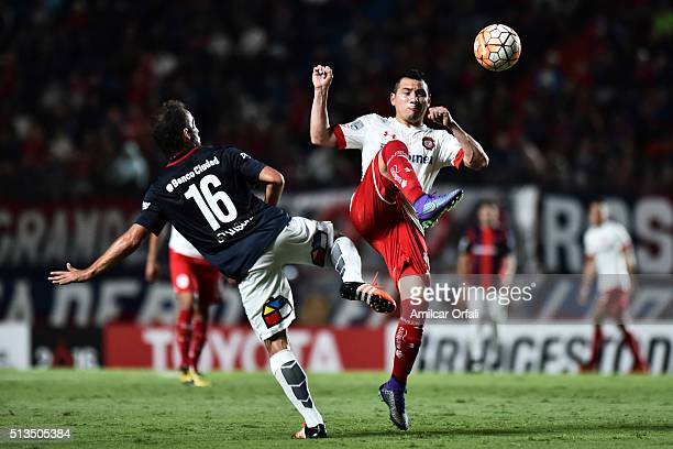 Fernando Belluschi of San Lorenzo and Antonio Ríos of Toluca during a group stage match between San Lorenzo and Toluca as part of Copa Bridgestone...