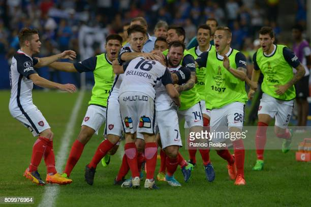 Fernando Belluschi of San Lorenzo celebrates with teammates after scoring the first goal of his team during a first leg match between Emelec and San...