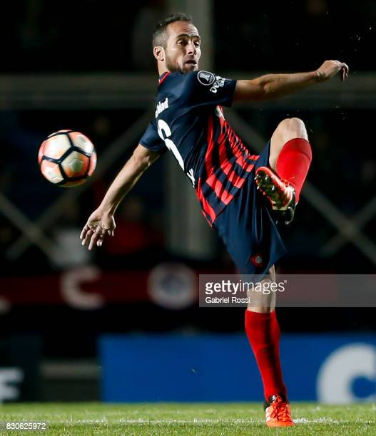 Fernando Belluschi of San Lorenzo kicks the ball during a second leg match between San Lorenzo and Emelec as part of round of 16 of Copa CONMEBOL...