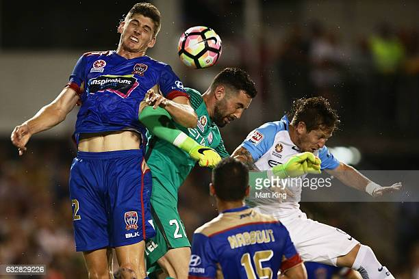 Fernando Brandan of Melbourne City and Melbourne City goalkeeper Dean Bouzanis compete for the ball against Harrison Sawyer of the Jets during the...