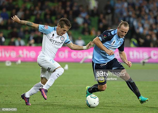 Fernando Brandan of Melbourne City challenges Rhyan Grant of Sydney FC during the FFA Cup Final match between Melbourne City FC and Sydney FC at AAMI...