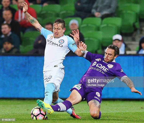 Fernando Brandan of the City and Joshua Risdon of the Glory compete for the ball during the round three ALeague match between Melbourne City FC and...