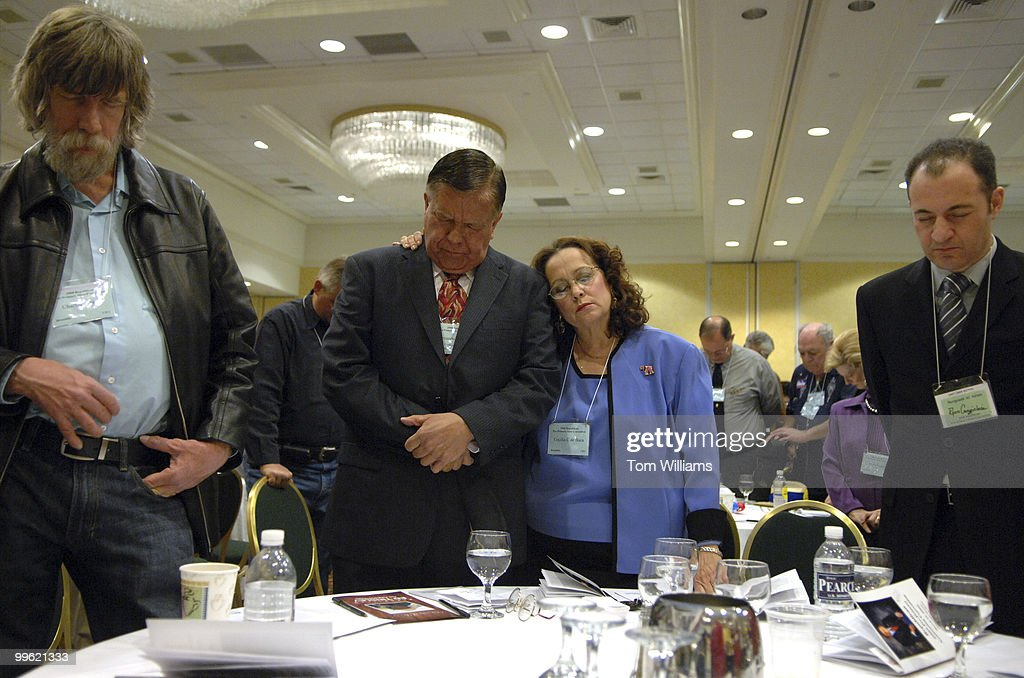 Fernando C de Baca and his wife Cecelia of Bernalillo County pray during the benediction of the state republican convention at the Marriott hotel in...