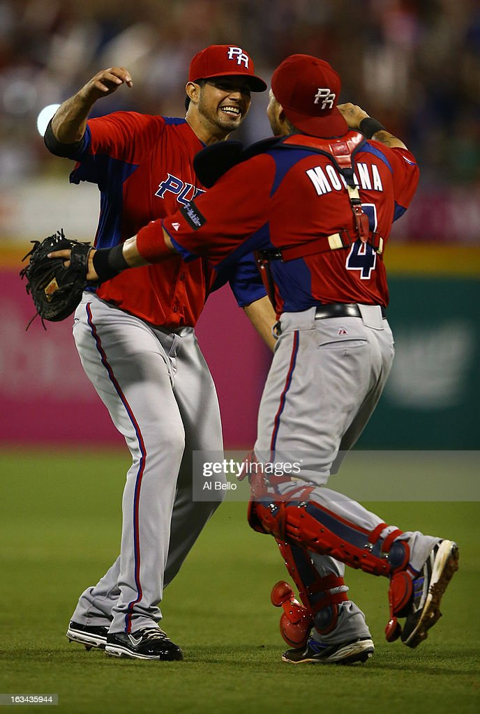 Fernando Cabrera #38 and <a gi-track='captionPersonalityLinkClicked' href=/galleries/search?phrase=Yadier+Molina&family=editorial&specificpeople=172002 ng-click='$event.stopPropagation()'>Yadier Molina</a> #4 of Puerto Rico celebrate a 6-3 win against Venezuela during the first round of the World Baseball Classic at Hiram Bithorn Stadium on March 9, 2013 in San Juan, Puerto Rico.