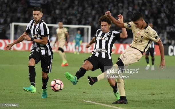 Fernando Camilo Farias of Botafogo de Futebol e Regatas in action against Xavier Arreaga of Barcelona SC during Copa Libertadores of America match...