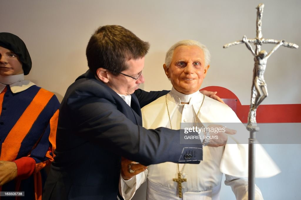 Fernando Canini (L), administrator of Rome wax museum, take care of the statue of Pope Benedict XVI at the museum on March 11, 2013 in Rome. Catholic cardinals had a final day of jockeying for position today before shutting themselves into the Sistine Chapel to elect a new pope after Benedict XVI's shock resignation, with an Italian and a Brazilian who both head powerful archdioceses among the top contenders.