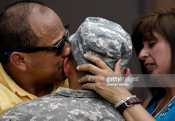 Fernando Cano and his wife his wife Vickie say goodbye to their son US Army PFC Benjamin Cano before he deploys to Afghanistan with the 293rd...