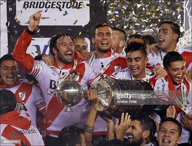 Fernando Cavenaghi and Gonzalo Martinez celebrate with the trophy after winning a second leg final match between River Plate and Tigres UANL as part...