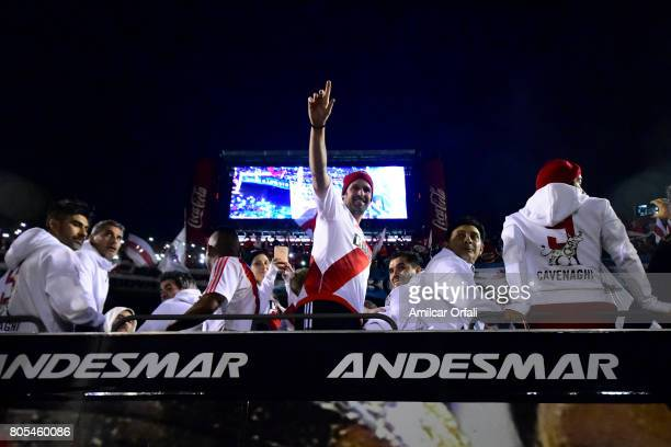 Fernando Cavenaghi greets fans next to Esteban Fuertes and Leonardo Astrada during Fernando Cavenaghi's farewell match at Monumental Stadium on July...