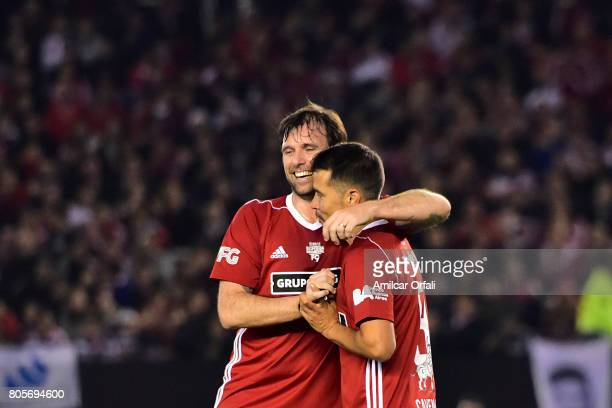 Fernando Cavenaghi hugs former soccer player Javier Saviola during Fernando Cavenaghi's farewell match at Monumental Stadium on July 01 2017 in...