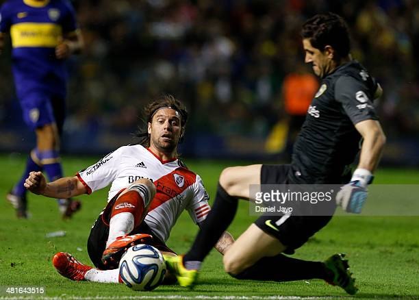 Fernando Cavenaghi of River Plate and Agustin Orion of Boca Juniors fight for the ball during a match between Boca Juniors and River Plate as part of...