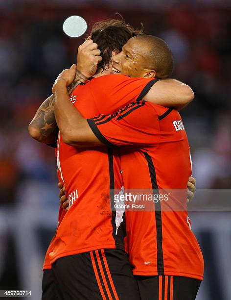 Fernando Cavenaghi of River Plate celebrates with Carlos Sanchez after scoring the third goal of his team during a match between Banfield and River...