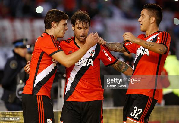 Fernando Cavenaghi of River Plate celebrates with his teammates after scoring the third goal of his team during a match between Banfield and River...
