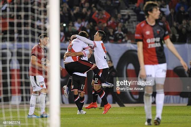 Fernando Cavenaghi of River Plate celebrates with teammates after scoring his team's second goal during a match between River Plate and Colon de...