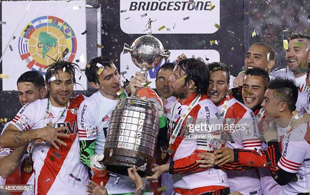 Fernando Cavenaghi of River Plate holds the trophy after winning a final match between River Plate and Tigres UANL as part of Copa Bridgestone...