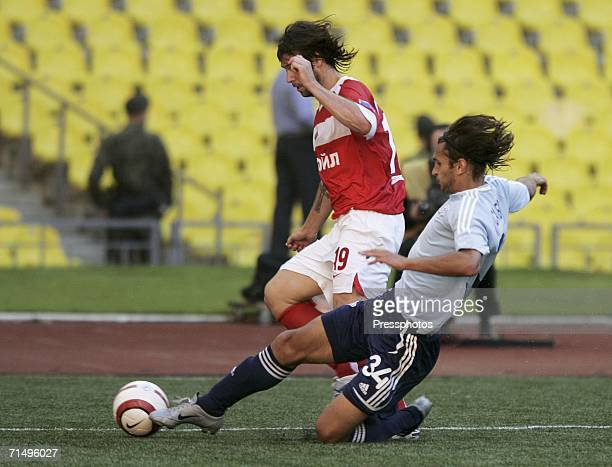 Fernando Cavenaghi of Spartak Moscow is tackled by Renat Sabitov of Saturn during the Football Russian League Championship match between Spartak...