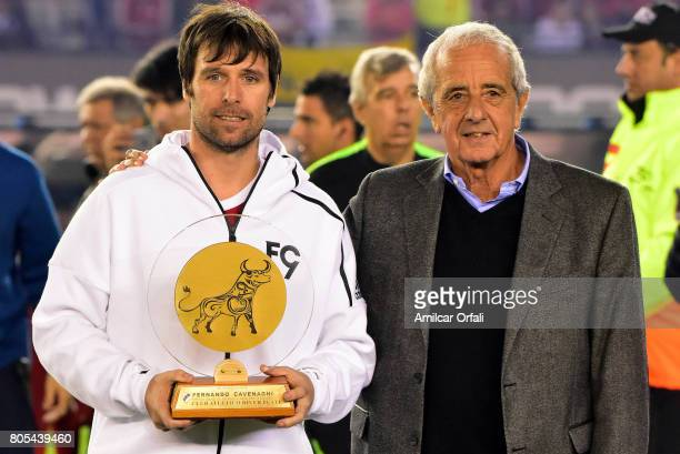 Fernando Cavenaghi poses with a trophy alongside Rodolfo D'Onofrio president of River Plate during Fernando Cavenaghi's farewell match at Monumental...