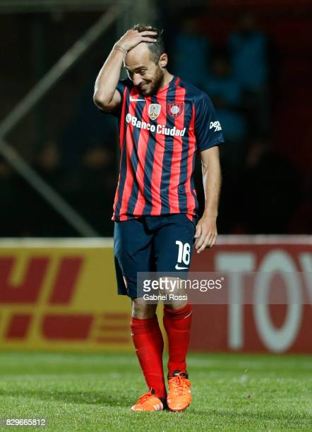Fernando Daniel Belluschi of San Lorenzo looks dejected after missing his penalty during the penalty shootout after a second leg match between San...