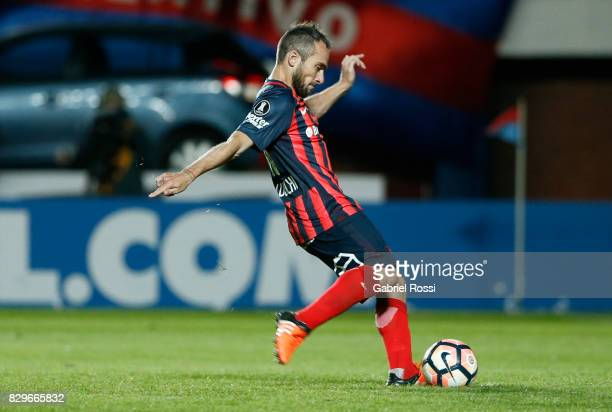 Fernando Daniel Belluschi of San Lorenzo takes a penalty during the penalty shootout after a second leg match between San Lorenzo and Emelec as part...
