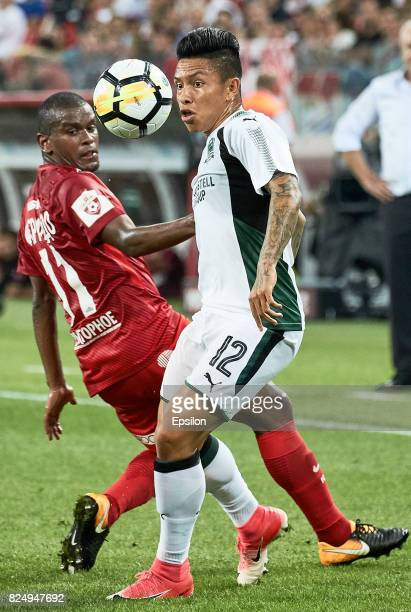 Fernando FC Spartak Moscow vies for the ball with Cristian Ramírez of FC Krasnodar during the Russian Premier League match between FC Spartak Moscow...