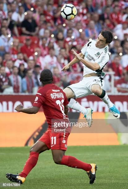 Fernando FC Spartak Moscow vies for the ball with Mauricio Pereyra of FC Krasnodar during the Russian Premier League match between FC Spartak Moscow...
