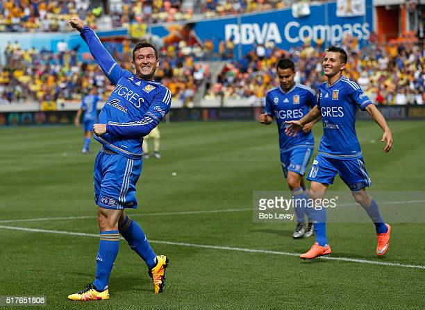 Fernando Fernandez of Tigres UANL celebrates with Jose Torres and Lucas Zelarayan #* a first half goal against Club America at BBVA Compass Stadium...