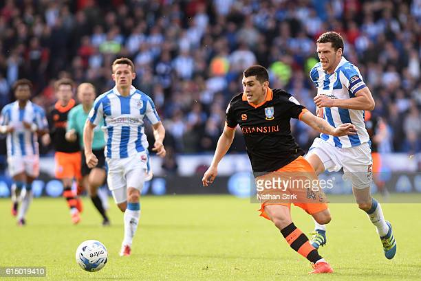 Fernando Forestieri of Sheffield Wednesday and Mark Hudson of Huddersfield Town in action during the Sky Bet Championship match between Huddersfield...