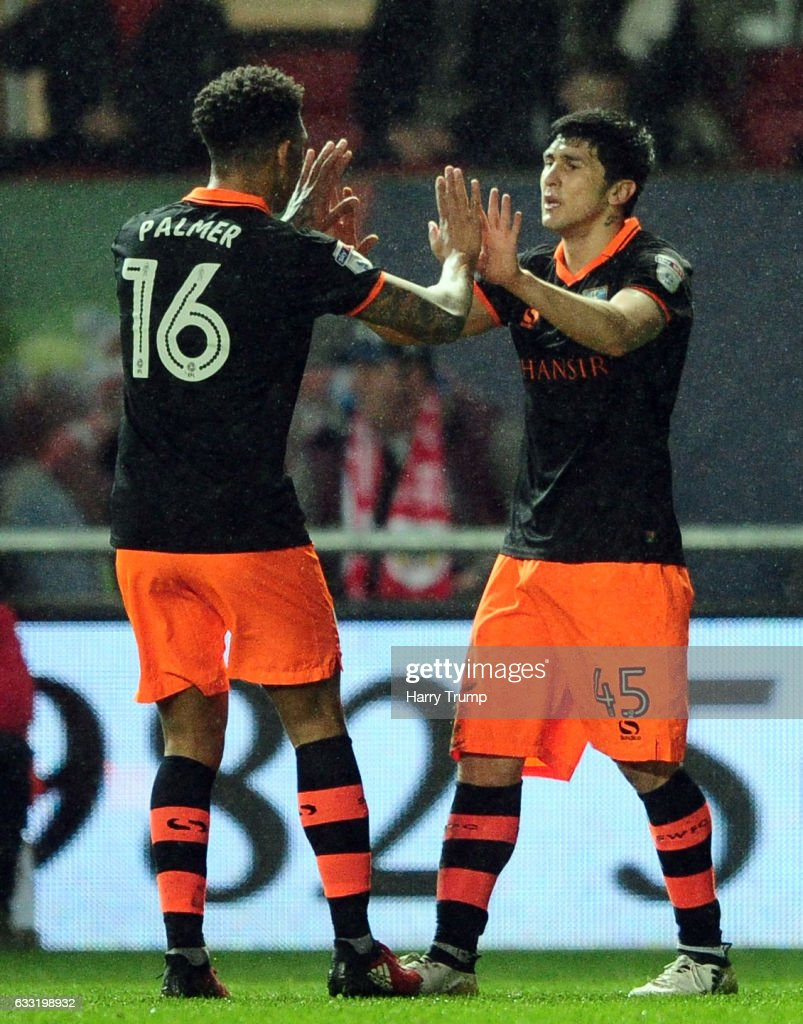 Fernando Forestieri of Sheffield Wednesday celebrates his side's goal with Liam Palmer of Sheffield Wednesday during the Sky Bet Championship match between Bristol City and Sheffield Wednesday at Ashton Gate on January 31, 2017 in Bristol, England.