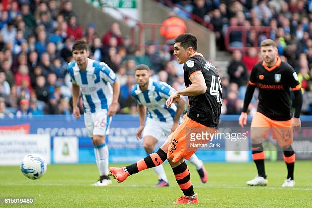 Fernando Forestieri of Sheffield Wednesday scores the opening goal from a penalty during the Sky Bet Championship match between Huddersfield Town and...