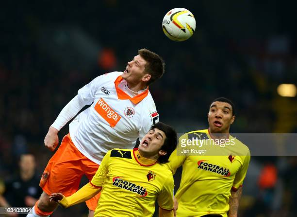 Fernando Forestieri of Watford battles for the arial ball with Gary MacKenzie of Blackpool during the npower Champions match between Watford and...