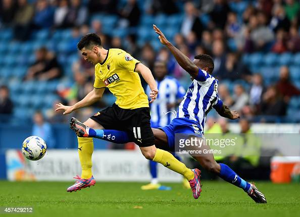 Fernando Forestieri of Watford battles with Jose Semedo of Sheffield Wednesday during the Sky Bet Championship match between Sheffield Wednesday and...