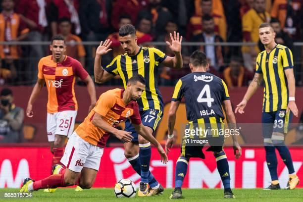 Fernando Fransisco Reges of Galatasaray SK Younes Belhanda of Galatasaray SK Nabil Dirar of Fenerbahce SK Mauricio Isla of Fenerbahce SK Roman...