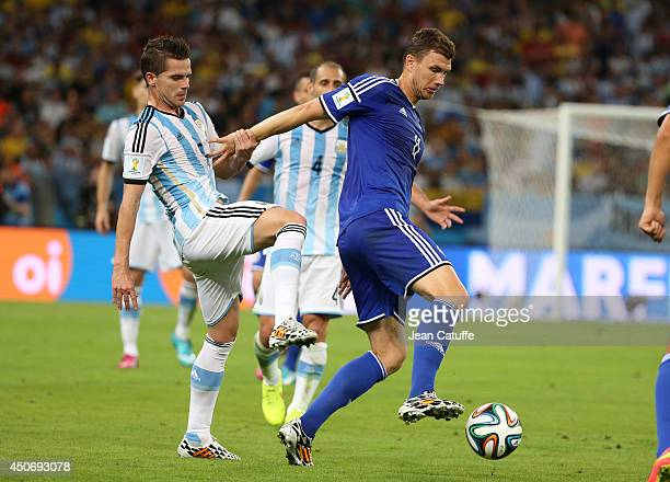 Fernando Gago of Argentina and Edin Dzeko of BosniaHerzegovina in action during the 2014 FIFA World Cup Brazil Group F match between Argentina and...