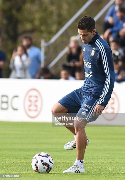 Fernando Gago of Argentina controls the ball during a training session at Argentine Football Association 'Julio Humberto Grondona' training camp on...