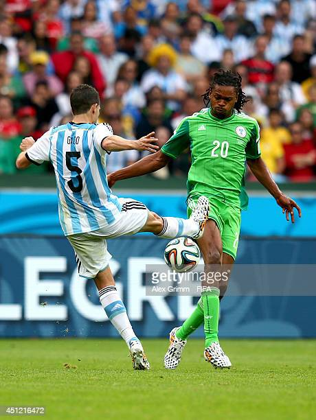Fernando Gago of Argentina controls the ball next to Okechukwu Uchebo of Nigeria during the 2014 FIFA World Cup Brazil Group F match between Nigeria...