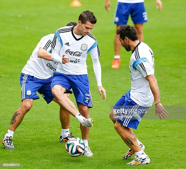 Fernando Gago of Argentina plays the ball during a training session at Cidade do Galo Training Camp on June 12 2014 in Belo Horizonte Brazil