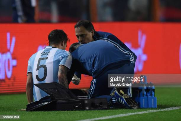 Fernando Gago of Argentina receives medical attention after an injury during a match between Argentina and Peru as part of FIFA 2018 World Cup...