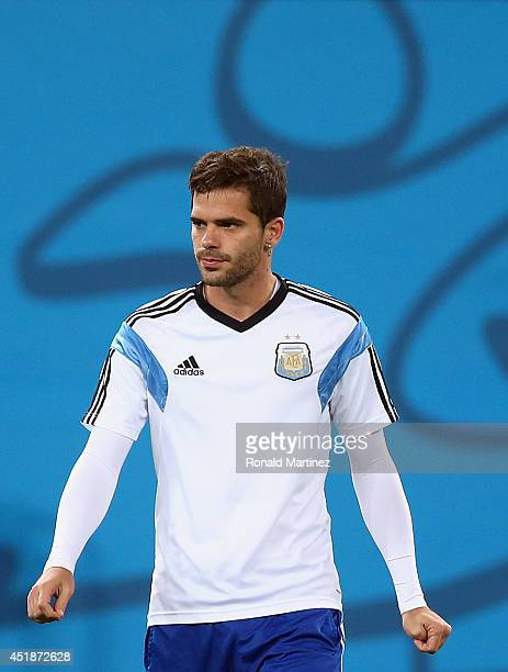 Fernando Gago of Argentina warms up during a training session at Arena de Sao Paulo on July 8 2014 in Sao Paulo Brazil