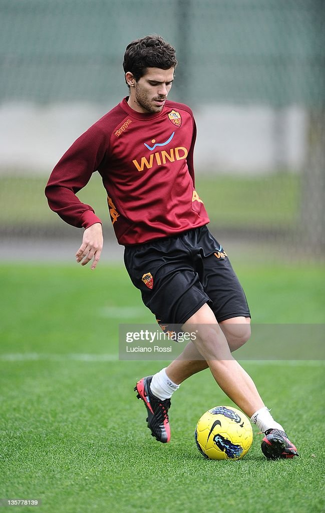 <a gi-track='captionPersonalityLinkClicked' href=/galleries/search?phrase=Fernando+Gago&family=editorial&specificpeople=674234 ng-click='$event.stopPropagation()'>Fernando Gago</a> of AS Roma runs with the ball during a AS Roma training session at Centro Sportivo Fulvio Bernardini on December 14, 2011 in Rome, Italy.