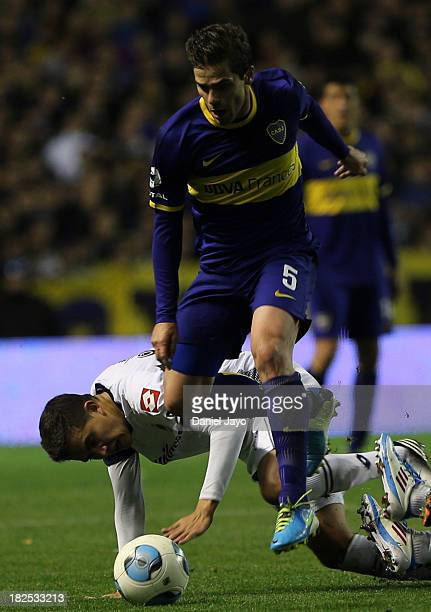 Fernando Gago of Boca Juniors and Lucas Perez Godoy of Quilmes fight for the ball during a match between Boca Juniors and Quilmes as part of the...