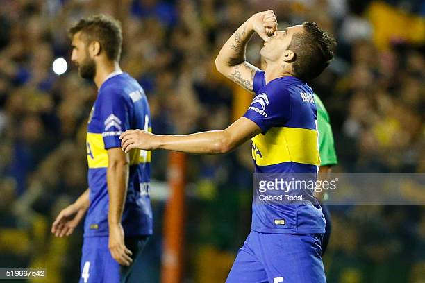 Fernando Gago of Boca Juniors celebrates with his teammates after scoring the first goal of his team during a match between Boca Juniors and Bolivar...