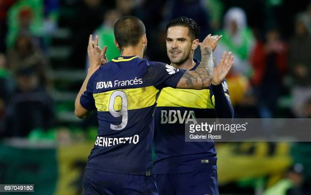 Fernando Gago of Boca Juniors celebrates with teammate Dario Benedetto after scoring the third goal of his team through a penalty kick during a match...