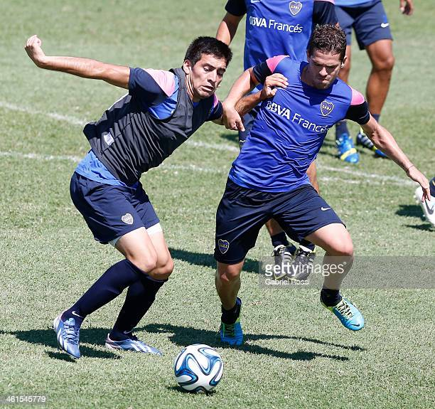 Fernando Gago of Boca Juniors figths for the ball during a Boca Juniors training session at Casa Amarilla on January 09 2014 in Buenos Aires Argentina