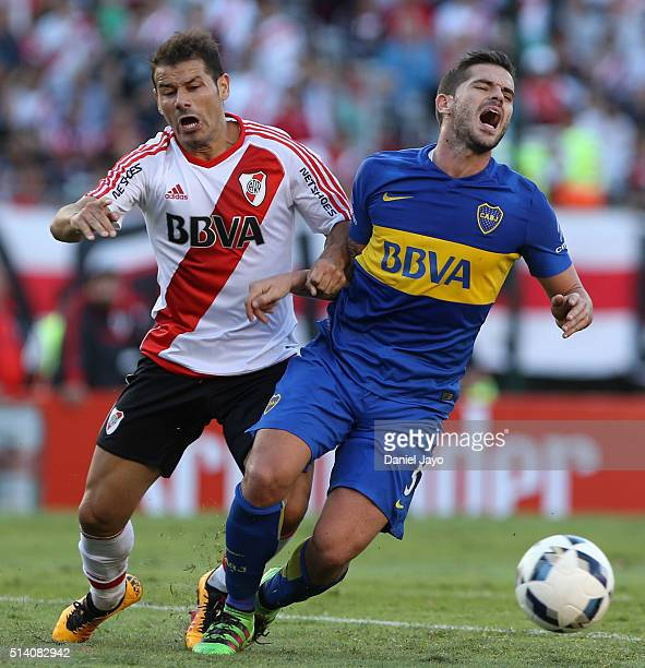 Fernando Gago of Boca Juniors is challenged by Rodrigo Mora of River Plate during a match between River Plate and Boca Juniors as part of sixth round...