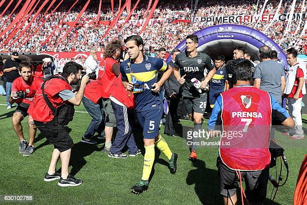 Fernando Gago of Boca Juniors leads his team out ahead of the Argentine Primera Division match between River Plate and Boca Juniors at the Estadio...