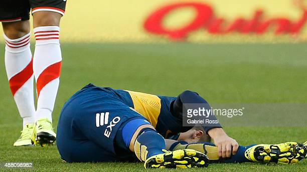 Fernando Gago of Boca Juniors lies injuried on the grass during a match between River Plate and Boca Juniors as part of 24th round of Torneo Primera...