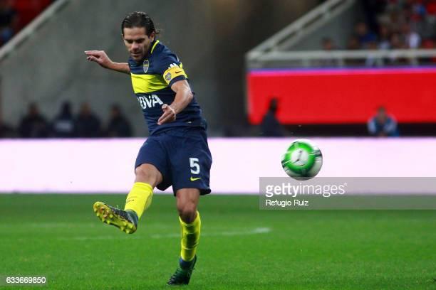 Fernando Gago of Boca Juniors plays the ball during a friendly match between Chivas of Mexico against Boca Juniors of Argentina named Duelo de...